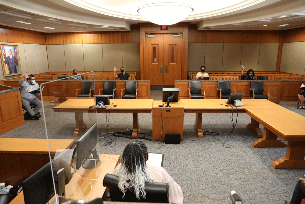 Jury Deliberating in a Courtroom